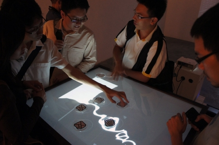 The interactive map table installation at the exhibition