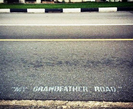 Spray painting on road allegedly by street artist SKL0